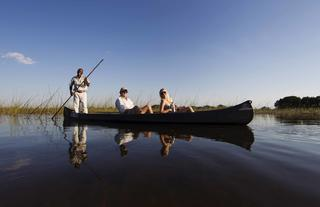Explore the intricacies of the Okavango Delta the old fashioned way, in the traditional contours of the Mokoro (traditional dugout canoe)