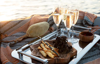 Champagne and snacks sunset