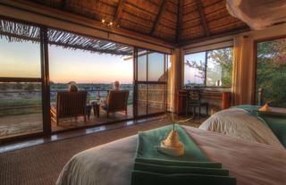 Luxurious thatched and glass fronted suites